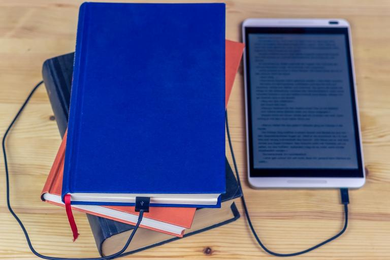 Image of books and an ebook reader