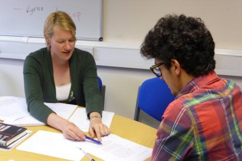 Language tutor working with a student